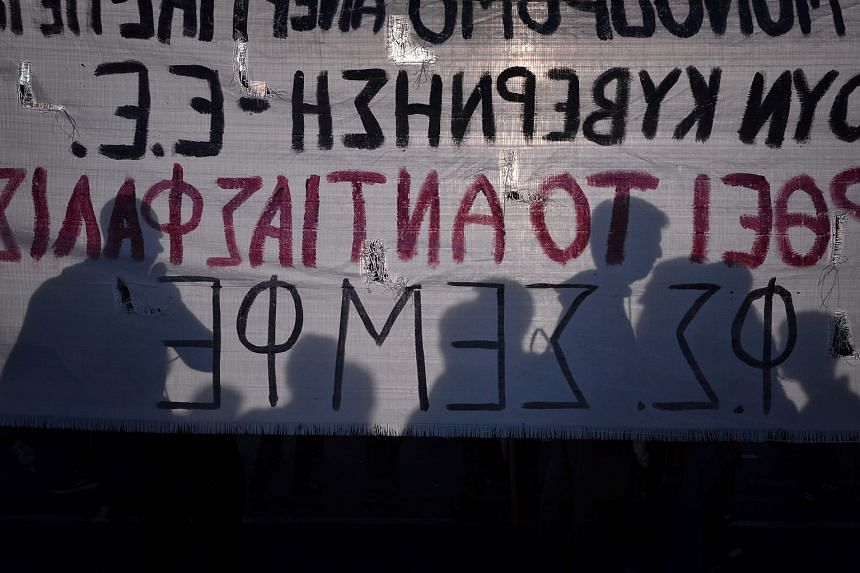 Protesters in Athens on May 8 at a rally against the latest reform measures demanded by Greece's creditors. IMF's debt- restructuring proposal goes much further than plans advanced by euro-zone creditors locked in talks to trigger Greece's next aid p