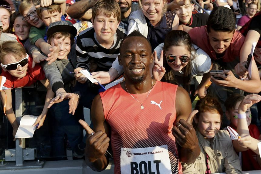 Jamaican Usain Bolt sharing the limelight with adoring fans after winning the 100m at the IAAF Ostrava Golden Spike meeting in Ostrava, Czech Republic. He clocked 9.98sec in his second race of the year.