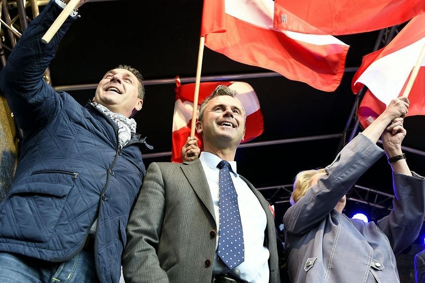 Mr Norbert Hofer (with his trademark cane) at his final election rally in Vienna on Friday, when he expressed confidence of victory. With him is party leader Heinz-Christian Strache (left).