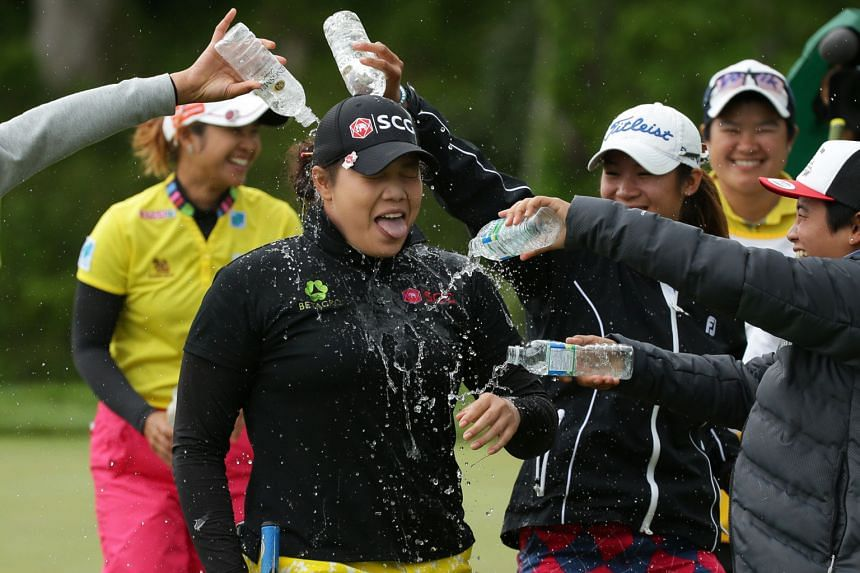 Ariya Jutanugarn is doused with water after winning the Kingsmill Championship. She became the first Thai to win on the LPGA Tour the previous week following her win in Alabama.