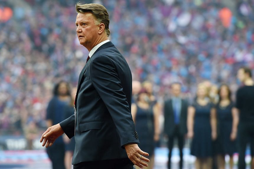 Manchester United manager Louis van Gaal walks onto the pitch before the FA Cup final on Saturday. The 2-1 victory against Crystal Palace did nothing to rescue his long-term prospects at the historic club.