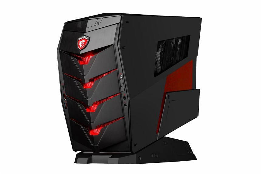 """A sturdy metallic carrying handle at the back of its chassis lets you """"carry this lightweight gaming beast around from one LAN party to the next""""."""