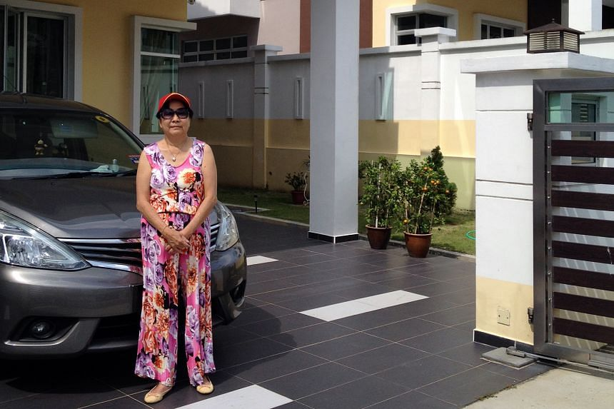 Mrs Amy Tan (left) no longer drives to Singapore, while Ms Noraini Mokhtar (right) spends hours on the road each day commuting between her home in Johor Baru and Singapore.