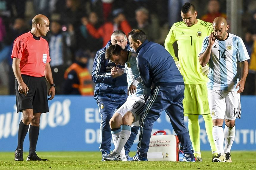 Lionel Messi is helped to his feet after suffering an injury to his back. The extent of his injury is unknown, with the Barcelona forward now facing a race to be fit for Argentina's opening game in the Copa America Centenario in less than two weeks.