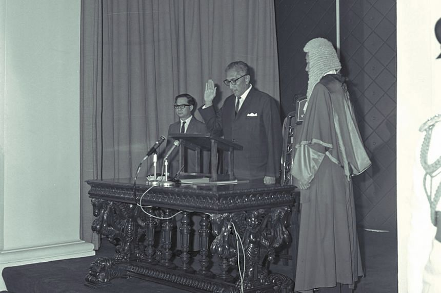President Yusof Ishak being sworn in for a third term at the Istana Negara in 1967. The oath was administered by Chief Justice Wee Chong Jin, and with them was acting Prime Minister Toh Chin Chye. Mr Yusof became President of Singapore after the coun