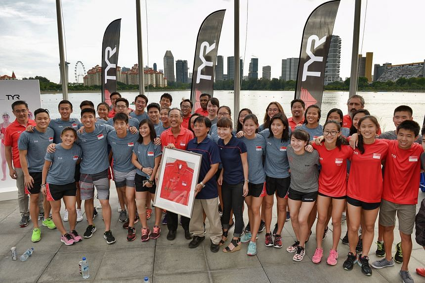 Singapore Swimming Association president Lee Kok Choy (centre of front row, in red) together with the national swimming athletes, after sealing a record sponsorship deal with apparel maker TYR. The partnership will see its athletes across four discip