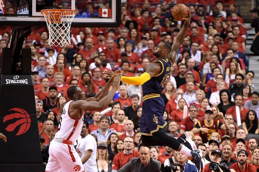 LeBron James going for a dunk in the second quarter of the Cavaliers' Game 6 win over the Raptors in the Eastern Conference finals. The Cavs star scored 33 points to lead his team to their second straight NBA Finals appearance.