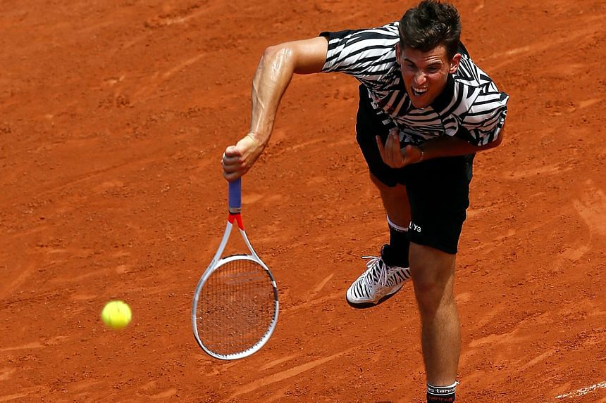Austria's Dominic Thiem in action yesterday against Alexander Zverev of Germany. Thiem won their third-round match 6-7 (4-7), 6-3, 6-3, 6-3. Shortly after, rain brought all other matches to a halt.