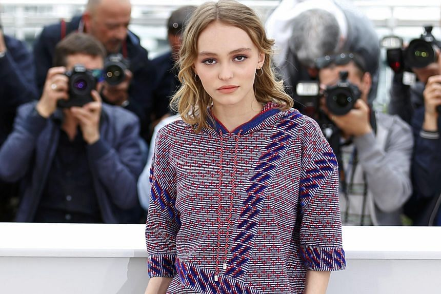Lily-Rose Depp (above) posted a photo on Instagram showing herself as a baby, with her dad holding her hands and helping her walk.