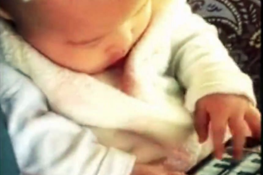 Jay Chou's daughter Hathaway playing on a toy piano in a video of a song he wrote for her.