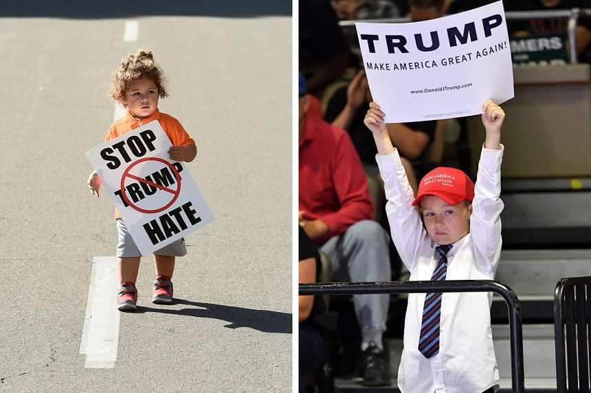 An unidentified boy with a pro-Trump sign at a rally for the candidate in Fresno last week. Mr Trump has pitched much of his election rhetoric at working-class white voters who welcome his hard line on immigration and trade. Two-year-old Noah Gomez w