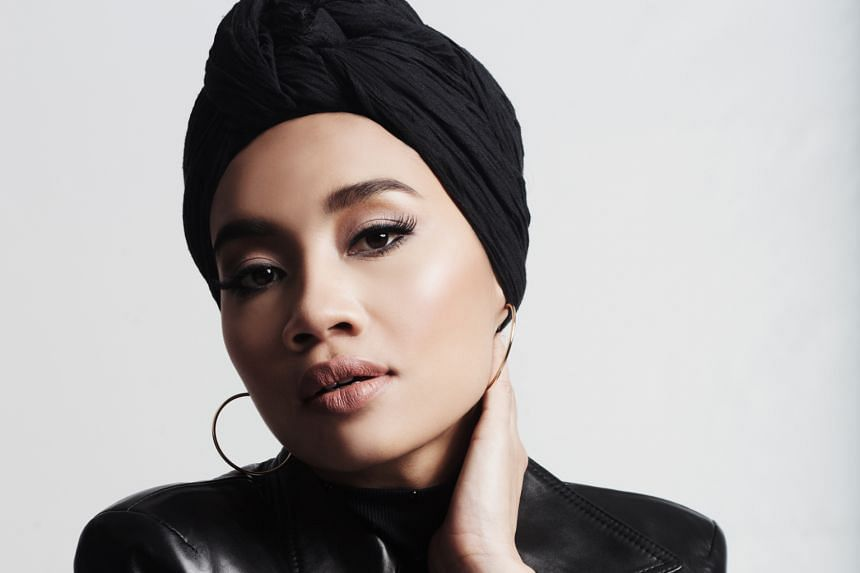 Yuna got to work with Usher and their single is doing well on the Billboard chart.
