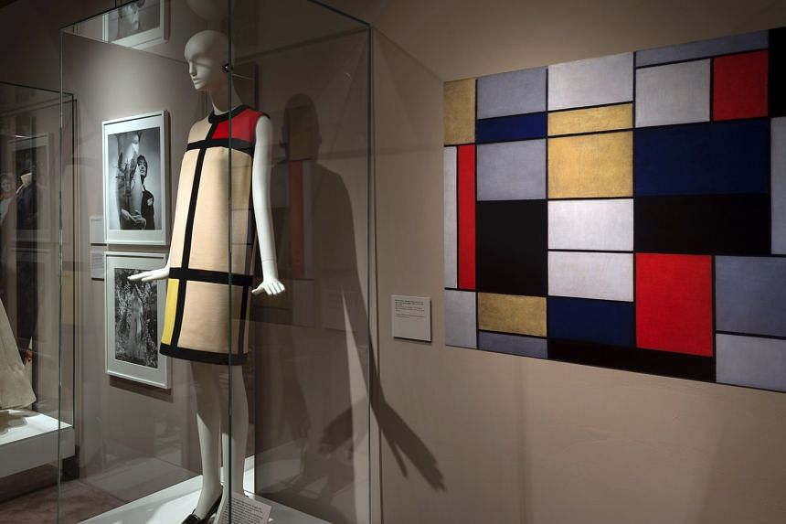 A cocktail dress (above) by Yves Saint Laurent, inspired by an oil painting by Dutch painter Piet Mondrian, and a wooden dress (right) by Japanese designer Yohji Yamamoto at the Across Art And Fashion exhibition. Shoes by Italian designer Salvatore F