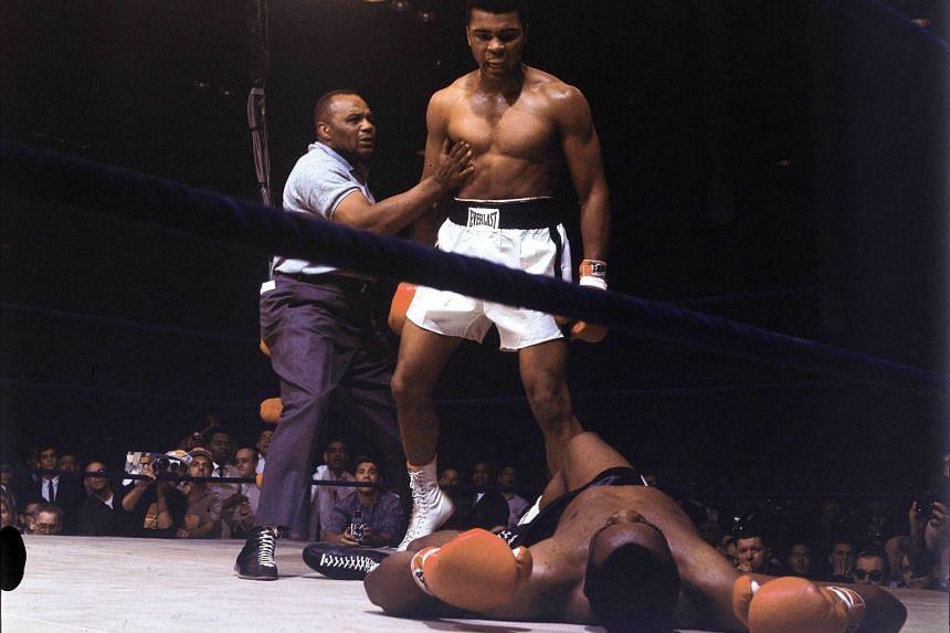 May 25, 1965: Ali standing over a fallen Sonny Liston in the second of two fights between the two. Liston was world heavyweight champion when they first fought in February 1964. Liston lost that fight. Ali went on to clinch the world heavyweight titl