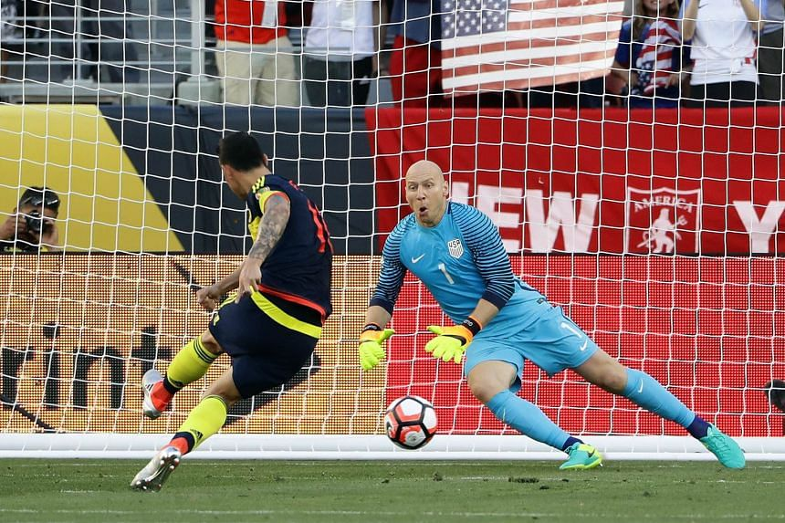 Colombia skipper James Rodriguez sending US goalkeeper Brad Guzan the wrong way from the spot to seal a 2-0 win for his side and pile on the pressure for US coach Jurgen Klinsmann.