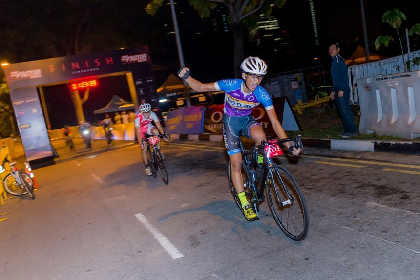 Waving a triumphant right fist, Muhammad Ghazzi Krisna crosses the finish line in first place, as he topped the 56km club challenge at the TRI-Factor Bike 2016 yesterday. His time of 1hr 23min 39sec beat Merrill Chua (behind) by a second. The mass cy