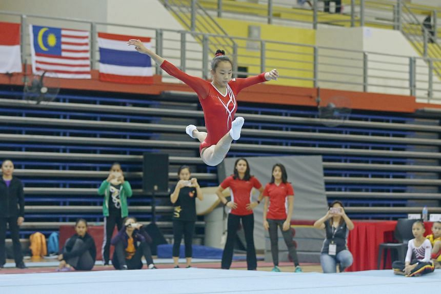 Tan Sze En executing her floor routine at the Singapore Open. She scored 13.600 points to win gold.