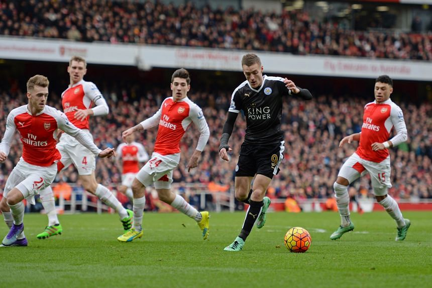 Leicester City striker Jamie Vardy (right) taking on the Arsenal defence in a Premier League match last season. Vardy won the title with the Foxes but could be lining up for Arsenal next season after the Gunners triggered the release clause in his co