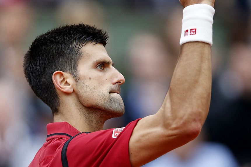 Novak Djokovic after winning a point during the French Open final against Andy Murray. The four-set victory allowed the Serb to stretch his winning record over the Scot to 24-10 overall and 8-2 in Grand Slams. For Murray, it was his eighth loss in 10