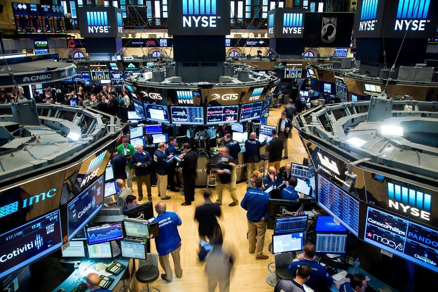 The trading floor of the New York Stock Exchange. US markets, which tumbled at the start of the year, have recouped their losses, with the Dow Jones Industrial Average up 2.08 per cent for 2016 as at the end of last month.