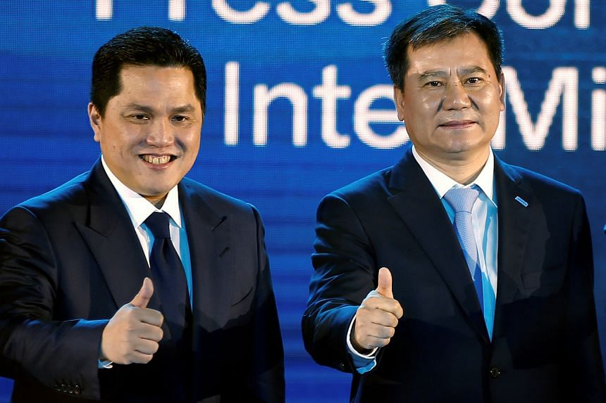 Chinese retailer Suning's chairman Zhang Jindong (right), posing for pictures alongside Inter president Erick Thohir during a press briefing in Nanjing, has promised to invest in the Milan giants' playing squad after purchasing a majority stake in th