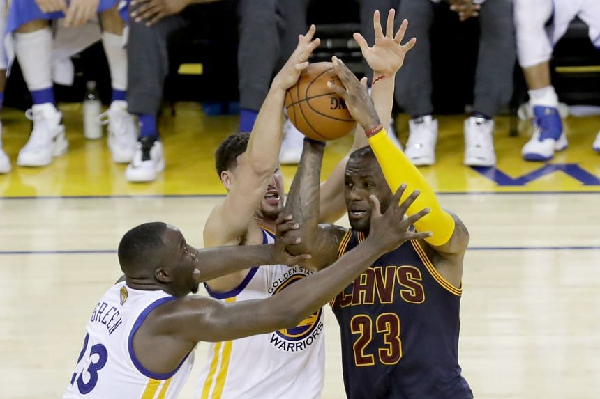 Cleveland forward LeBron James struggles to shrug off the attentions of Golden State's Klay Thompson and Draymond Green during the Cavaliers' 110-77 Game 2 defeat by the Warriors. Green notched a game-high 28 points as the Warriors opened up a 2-0 se