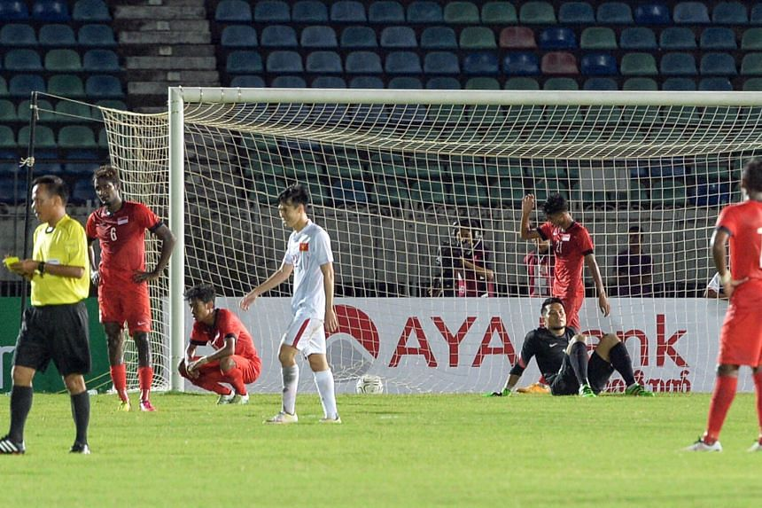 Despair for Singapore in extra time against Vietnam in Yangon. After two matches with new coach Sundram in charge, it is clear he favours the team soaking up pressure and defending deep before hitting on the counter.