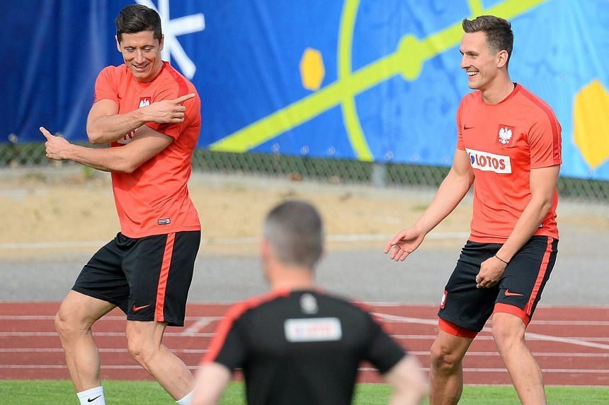 Polish forwards Robert Lewandowski (left) and Arkadiusz Milik will be relied upon to provide the firepower against their more heralded opponents at Euro 2016. The duo combined with devastating effect in qualifying, accounting for 19 of Poland's 33 go