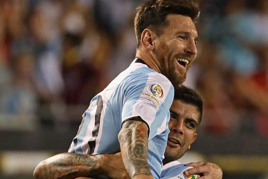 Lionel Messi gets a lift from team-mate Ever Banega after scoring from a free kick to put Argentina 3-0 up against Panama. The 5-0 rout assured them a spot in the quarter-finals and they are likely to top Group D.