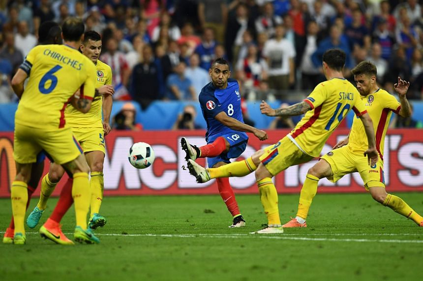 """With the clock ticking down, Dimitri Payet (centre) scores the dramatic winner in France's 2-1 victory in the Group A encounter against Romania at Stade de France on Friday. The host nation's Man of the Match said later: """"There had been a lot of stre"""