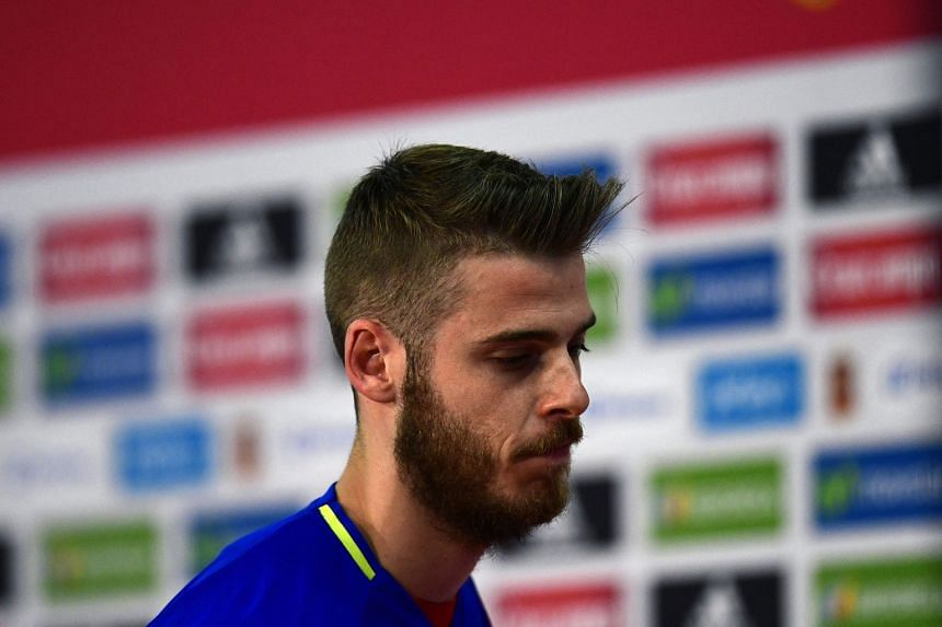 """A downcast Spain goalkeeper David de Gea leaving a press conference, where he angrily denounced the claims as """"a lie"""". News reports allege he tried to arrange a prostitute for five United team-mates. Spain coach Vicente del Bosque has not decided who"""