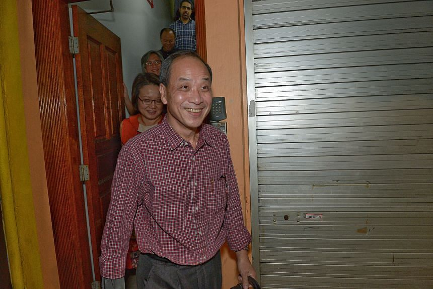 Emerging from the Workers' Party's HQ last Tuesday were (from the front) Mr Low Thia Khiang, Ms Sylvia Lim, Mr Chen Show Mao, Mr Muhamad Faisal Abdul Manap and Mr Pritam Singh.