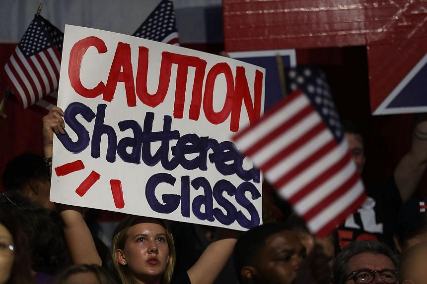 A Clinton supporter at a primary night event last Tuesday in Brooklyn, New York. Eight years ago, when Mrs Clinton bowed out of the presidential race, she declared that, thanks to the number of Democrats who voted for her, the highest, hardest glass