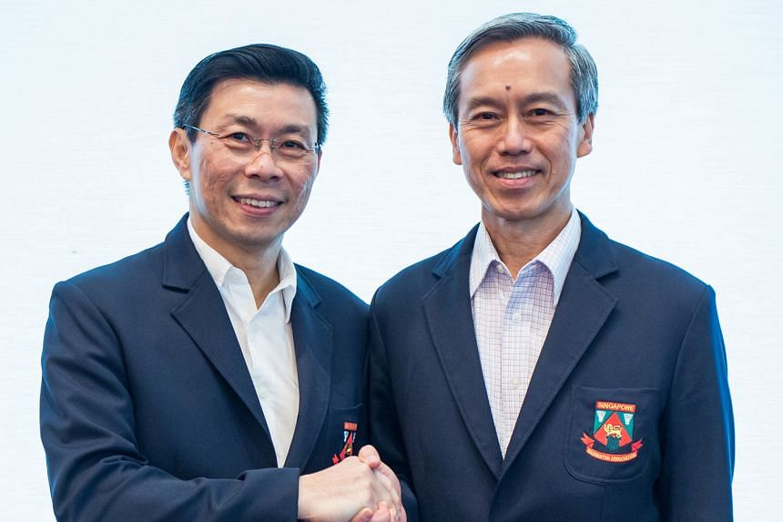 Lee Yi Shyan (left) handing over the SBA's reins to Tan Kian Chew. The latter is no stranger, having held two other posts before, and is set to keep his predecessor's policy of grooming youth rather than importing talent.