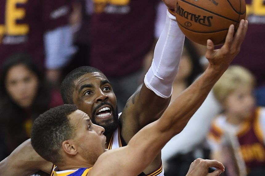 Golden State's Stephen Curry going up for a basket, as Cleveland's Kyrie Irving desperately tries to block him. For the first time in the NBA Finals series, the Warriors point guard had a solid game, with 38 points in the 108-97 win as Klay Thompson