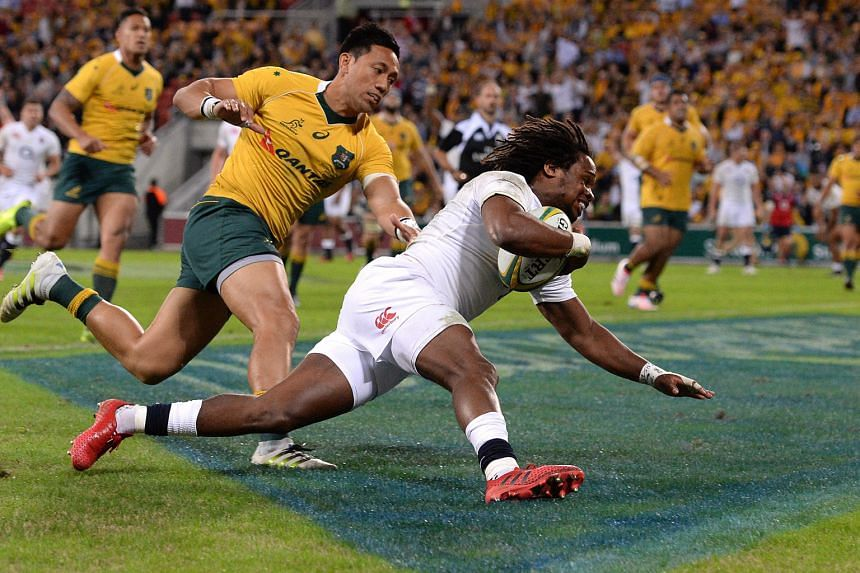 """Marland Yarde of England (right) scores a try during the first Test against Australia yesterday. Head coach Eddie Jones had earlier spoken of Yarde as having the potential to become a """"really special player"""" and the winger played a pivotal role in th"""