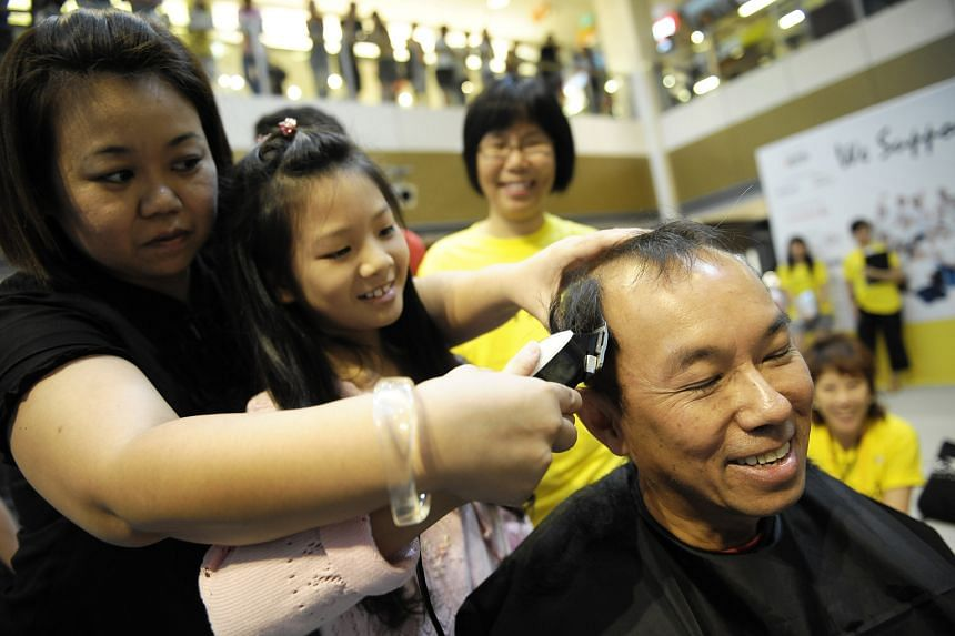 As editor, he had his hair shaved off (above) for Hair For Hope, a fund-raising event organised by the Children's Cancer Foundation.