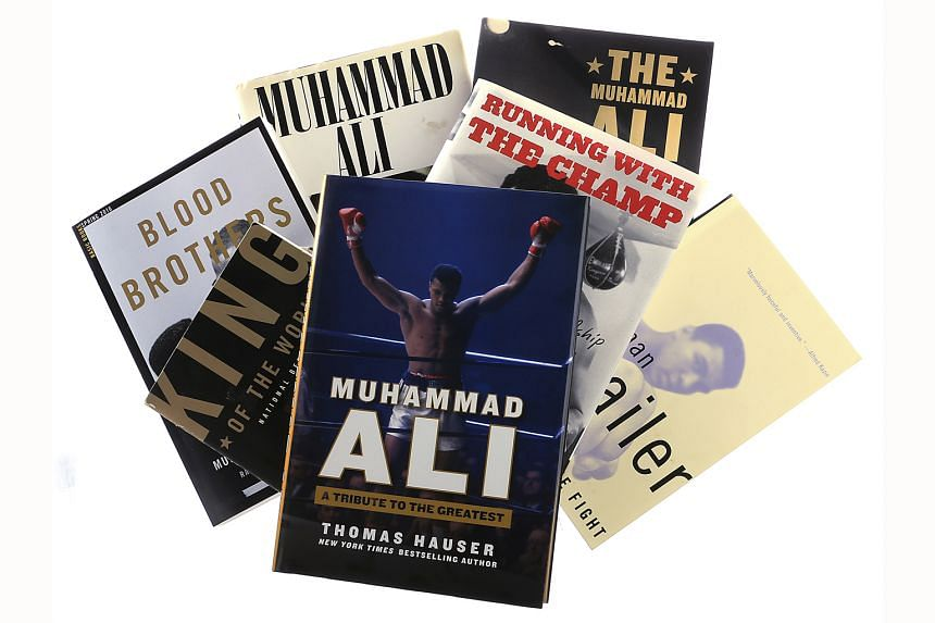 A selection of books (above) on the late boxer Muhammad Ali (left).