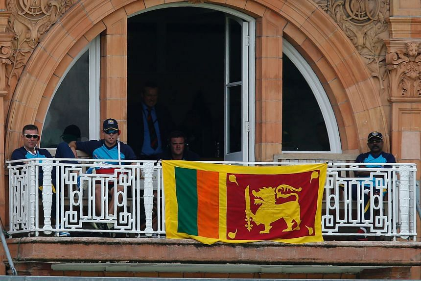 The national flag is draped over the balcony of the Sri Lanka dressing room at Lord's, in protest against an incorrect no-ball call that gave England batsman Alex Hales a reprieve.