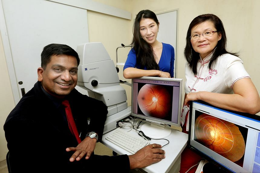From left: Professor Agrawal, Dr Li and Professor Leo with photographs of retinas that they and collaborators are measuring and analysing for changes in blood vessels morphology associated with dengue infection.