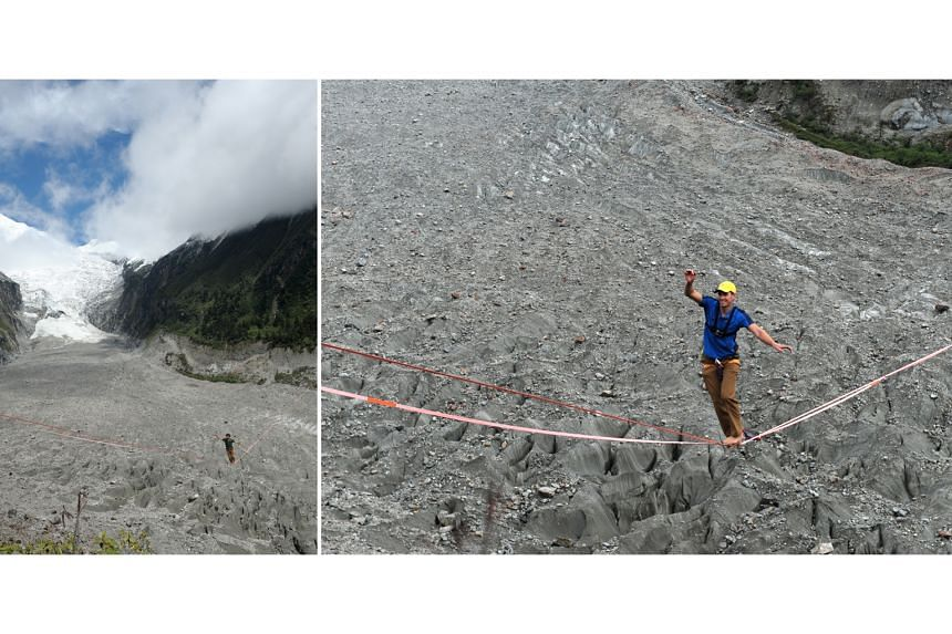 Slackline walkers negotiating a line strung across the Hailuogou glacier forest park in China's Sichuan province on Saturday. In a contest, participants were required to walk along a slackline that was 830m long and 3,600m high. French slackline walk