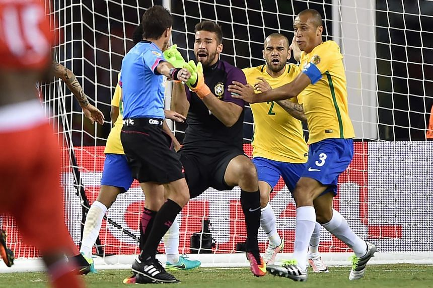 From top: Brazilian players complaining to Uruguayan referee Andres Cunha, after Peru's Raul Ruidiaz scored with his arm in their Copa America Centenario football match. Elias' last-gasp attempt being saved by Peru goalkeeper Pedro Gallese.