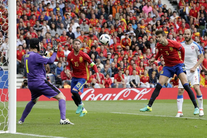 Gerard Pique of Spain (second right) heading home the only goal of the match - and his fifth in total for his country - with just three minutes remaining in the Euro 2016 Group D encounter yesterday.