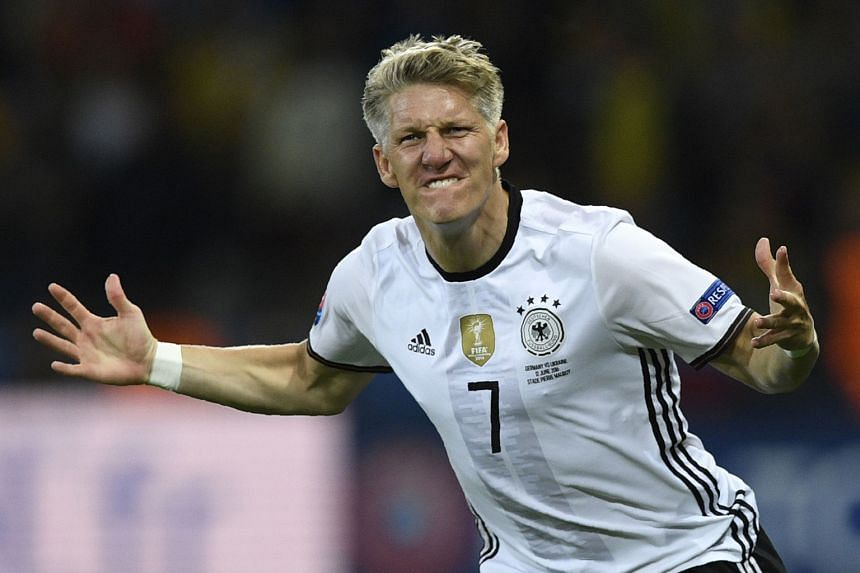 Midfielder Bastian Schweinsteiger is ecstatic after scoring Germany's second goal to guarantee three points against Ukraine.