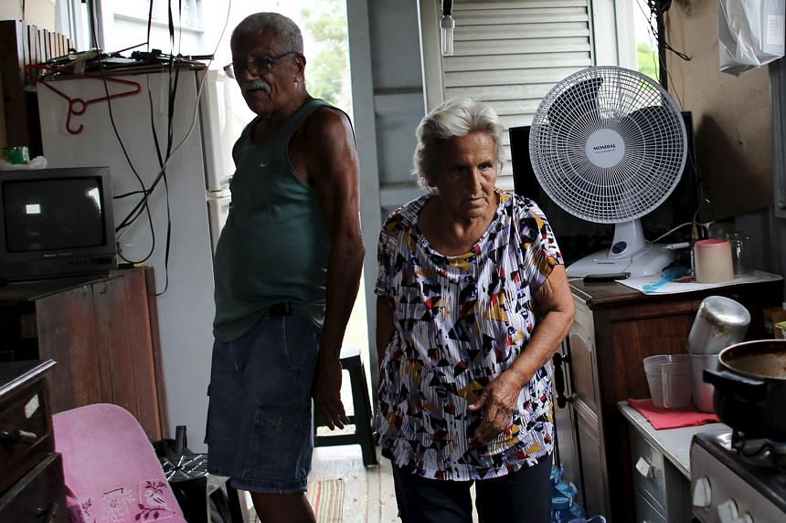 A couple in their 70s inside their shipping-container home in Brazil and (below) an elderly woman out shopping in Beijing. People are living longer and more money has to go into savings.
