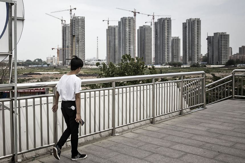 Investment in China's real estate in May posted its first year-on-year slowdown in growth since December although property sales by area surged more than 32 per cent.