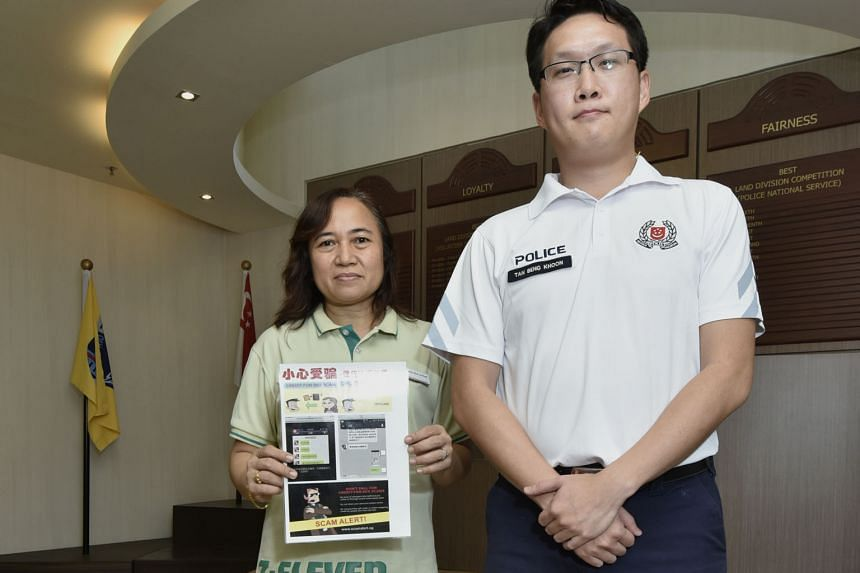 Store manager Rosida Arshad of a 7-Eleven outlet in Yishun with the scam advisory alert to help prevent customers from falling prey to the credit-for-sex scam. With her is community policing unit officer Tan Beng Khoon from Yishun North neighbourhood