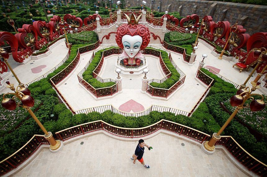 A man visiting Shanghai Disney Resort during a Grand Opening event in Shanghai.