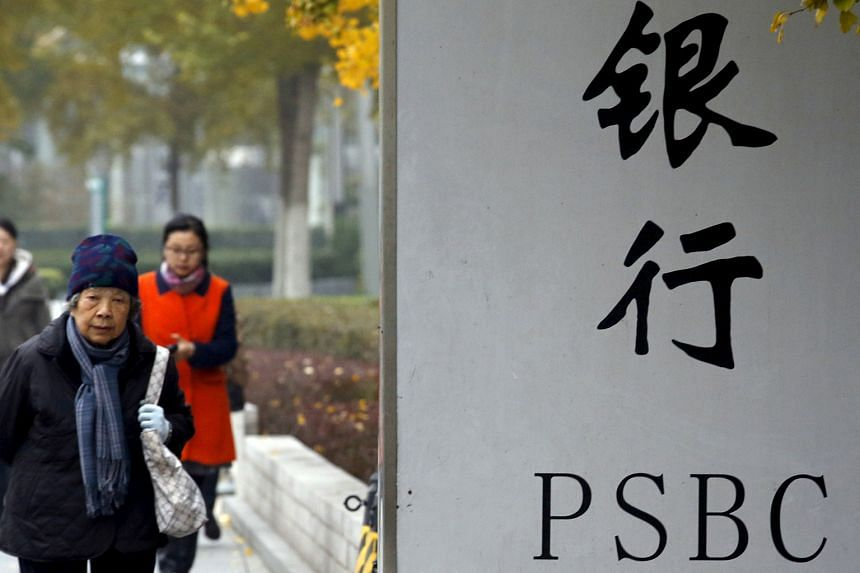 The Postal Savings Bank of China has more than 40,000 branches nationwide, including this one in Beijing, and has about 500 million customers.