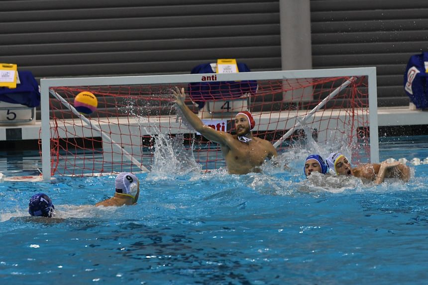 Australia goalkeeper James Stanton is unable to get his hand to this shot in a water polo friendly against Greece at the OCBC Aquatic Centre yesterday. Greece, bronze medallists at last year's Fina World Championships in Russia, won the game 6-4. The